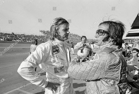 Race drivers Ronnie Peterson (L) of Sweden and Emerson Fittipaldi of Brazil chat in the pit area of Daytona International Speedway in Dayton Beach, Fla. on . Both men will compete in the International Race of Champions (IROC) at the Speedway