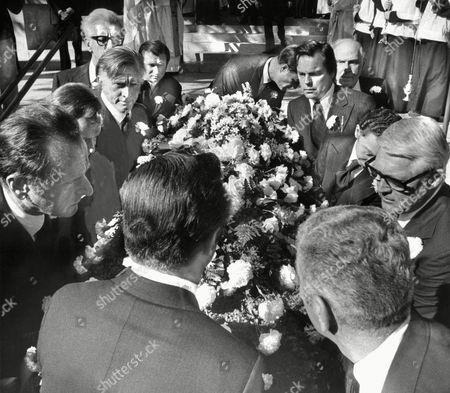 The casket of Rosalind Russell is carried from a Roman Catholic Church in Beverly Hills, after rites for the actress who died on Sunday at age 63. Pallbearers include Kirk Douglas (third from left), Robert Wagner (back, second from right) and Cary Grant (extreme right