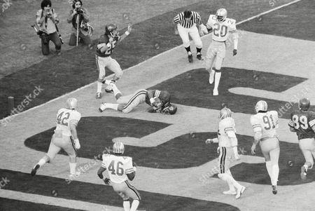 Stock Image of Wide receiver Shelton Diggs is on the ground with a two-point conversion pass, a gamble that gave Southern California an 18-17 victory over Ohio State in the Rose Bowl, in Pasadena. The play came in the final minutes. End John McKay, son of the coach, who had caught a touchdown pass a moment earlier is at extreme left. Bucks are Arnold Jones (42), Steve Luke (46), and Neal Colzie (20