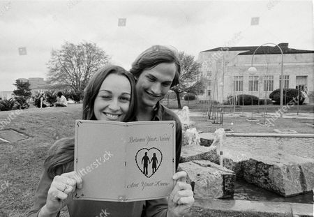 """Betty Smith, Rick Stewart Betty Smith, 20, and Rick Stewart, 20, both students at the University of Houston, begin to go through the new sex education pamphlet distributed by the student association to all U of H students who desire a copy, in Houston, Texas, . It seems that the pamphlet, """"Between Your Naval and Your Knees,"""" is being well received by the student body"""
