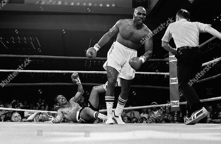 Heavyweight boxer Earnie Shavers is seen as he walks to a neutral corner after he knocked out Ken Norton in the first round of their fight in Las Vegas, Nev. The Referee is unidentified