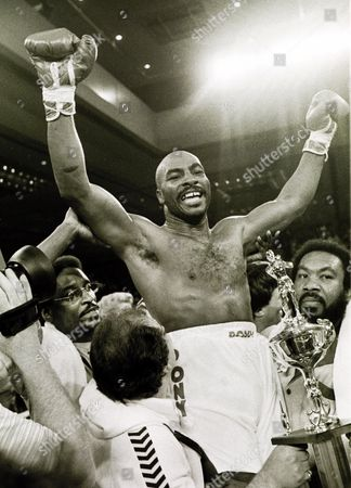 SHAVERS Heavyweight boxer Earnie Shavers raises his arms in victory after his first round knockout over Ken Norton in this photo in Las Vegas. On Feb. 5, in Shavers hometown of Warren, Ohio, he will be honored as Puncher of the Century by the fringe IBA. It's impossible to prove who was the hardest puncher of the century, but anybody making a list had better include Shavers. Of his victories on a 73-14-1 record in a career that began in 1959, 67 were by knockout