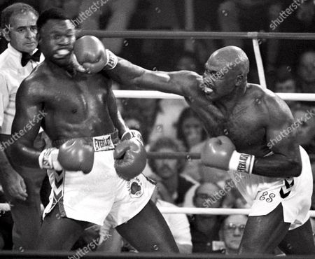 HOLMES SHAVERS Challenger Earnie Shavers, right, drives a right hand lead to the head of heavyweight champ Larry Holmes during their title fight in this photo in Las Vegas. Shavers knocked Holmes down, but the champ retained his title with an 11th round TKO. On Feb. 5, in Shavers hometown of Warren, Ohio, he will be honored as Puncher of the Century by the fringe IBA. It's impossible to prove who was the hardest puncher of the century, but anybody making alist had better include Shavers. Of his victories on a 73-14-1 record in a career that began in 1959, 67 were by knockout
