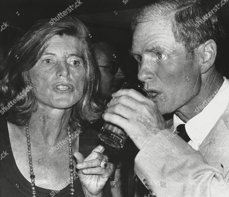 Eunice Shriver, wife of Sargent Shriver, chats with New Jersey's Gov. Brendan Byrne during a cocktail party in Manhattan, in connection with the Robert F. Kennedy Pro-Celebrity Tennis Tournament. The tournament is slated for Saturday at Forest Hills, N.Y