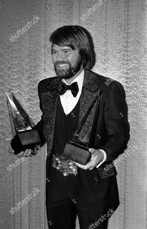 Glen Campbell Singer Glen Campbell holding the golden globe awards he was presented in Los Angeles, California on