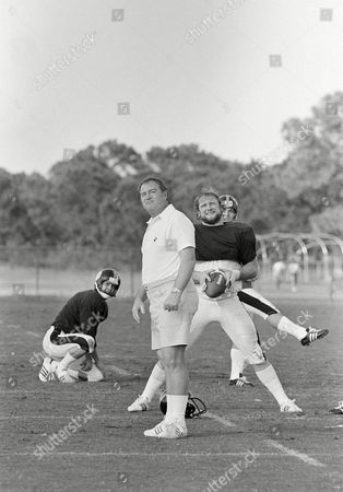 Chuck Noll, Roy Gerela, Craig Colquitt Pittsburgh Steelers coach Chuck Noll watches the flight of the ball off the toe of Roy Gerela during practice in Miami, . The holder at left is Craig Colquitt and the center is Mike Webster. The Steelers will be meeting the Dallas Cowboys in the Super Bowl