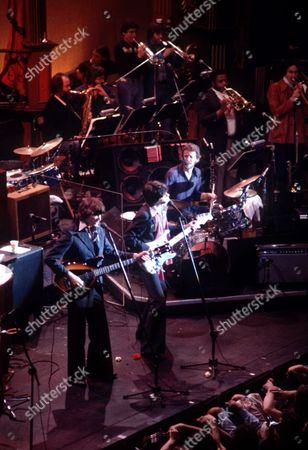 "HELM The rock group The Band is shown during their farewell concert ""The Last Waltz"" at the Winterland Auditorium in San Francisco in this photo. From left are Rick Danko, guitarist Robbie Robertson and drummer Levon Helm"