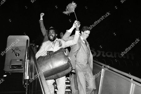 Dallas Cowboys' linebacker Thomas Anderson, left, and defensive tackle Randy White show their elation to a crowd gathered in Dallas on to welcome the Cowboys home after their 28-0 victory over the Los Angeles Rams. Henderson, who predicted the win, saying the Rams didn't have enough class for the Super Bowl, scored the final touchdown against the Rams on a 68-yard interception play. The Cowboys will meet the Pittsburgh Steelers in Super Bowl XIII in Miami, Jan. 21