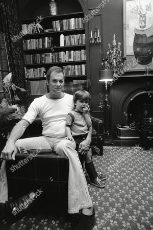 Actor Tony Curtis with his 2½-year-old son, Nicholas, in New York. Nicky is the son of Christine Kaufmann