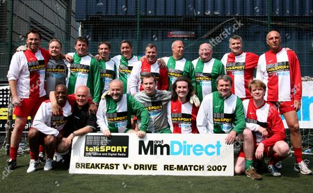 The Breakfast and Drive time teams. Top row (R-L) Jason Cundy, third from left Andy Townsend, third from right Alan Brazil, Ray Houghton and Alvin Martin. Bottom row (R-L) Ian Wright, Referee Keith Cooper, George Galloway, fifth from left Ian Danter