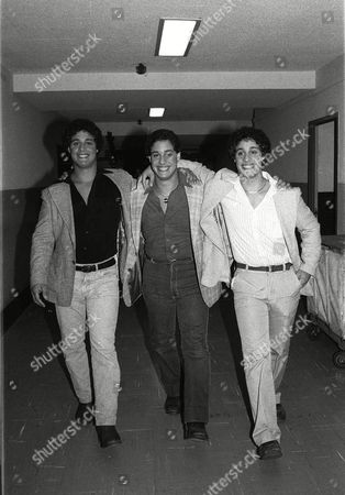 "ROBER Recently re-united triplets walk down a hallway at NBC-TV morning of Sept.26, 1980 after an appearance on the ""Today Show"" in New York. The brothers, adopted at birth by three separate families in the New York metropolitan area, only learned of each other's existence earlier in the week. From left, are: Eddy Gelland; David Kellman; and Robert Safran"