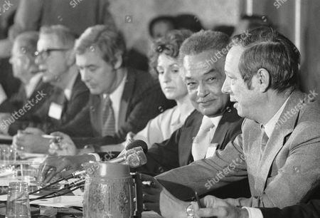 Michael Blumenthal, Dorothy Bledie, Coleman Young W. Michael Blumenthal, Secretary of Treasury designate, right, speaks at a meeting in Washington of the U.S. Conference of Mayors. At left is Dorothy Bledie and canter is Coleman Young, Mayor of Detroit. The group of Mayors are meeting in Washington for their 1977 Midwinter session