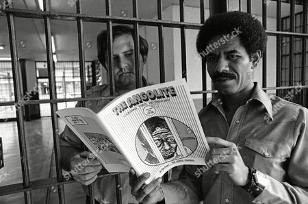 Wilbert Rideau, Noel Gaspard Wilbert Rideau, right, editor of The Angolite, shows a copy of the Angola, La., prison magazine to security guard Noel Gaspard through the bars, . Rideau, who is serving life for murder, was honored with a George Polk Award for special interest reporting on prison life