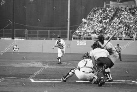 Los Angeles pitcher Tommy John delivers the first pitch in game one of the World Series on in Los Angeles. Batting is New York Yankees Mickey Rivers. The umpire is Ed Vargo. Catching for the Dodgers is Steve Yeager. First pitch was a called strike