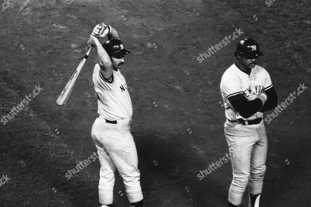New York Yankees sluggers Thurman Munson, left, and Reggie Jackson await the warm-up of Dodgers relief rookie Bob Welch in Los Angeles. Welch then fired two pitches to Munson who flied out to right, then struck out Jackson to end the game. The Dodgers won, 4-3