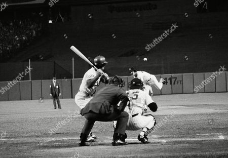 New York Yankees Ron Guidry delivers first pitch of third game of World Series to Los Angeles Dodgers Davey Lopes at Yankee Stadium in New York . Lopes flied out to Yankee centerfielder Mickey Rivers. Yankee catcher is Thurman Munson and umpire is John Kibler