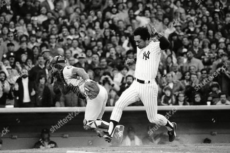 New York Yankees Roy White is about to step on the plate to give Yankees a 3-2 lead in third inning of World Series with Los Angeles Dodgers in New York . White and Mickey Rivers scored on hit by Thurman Munson. Dodger catcher Steve Yeager goes after bad throw by Dodgers Reggie Smith
