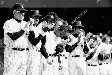 Members of the New York Yankees Applaud opening ceremonies at Yankee Stadium in New York on where the Yanks opened the defense of their world championship against the Milwaukee Brewers. From left are manager Bob Lemon, Willie Randolph, Thurman Munson, Cliff Johnson (behind Munson), Mickey Rivers, Graig Nettles (behind Rivers), Paul Blair and Bucky Dent