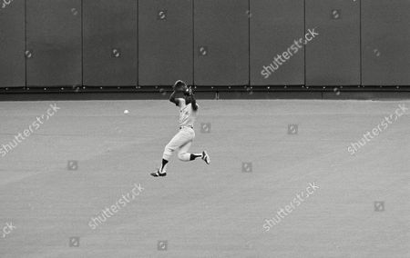 Yankee center fielder Mickey Rivers leaps high for a bouncing hit by Royals Amos Otis in fourth inning play in the second game of the American League championship series, Kansas City, Mo
