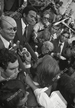 Moshe Dayan, Andrew Young Israeli Foreign Minister Moshe Dayan, top left, and Andrew Young, former U.S. ambassador to the United Nations, top center, hold a news conference outside the Regency Hotel in New York, . Dayan said he would welcome Young to visit his country, as long as it had nothing to do with the PLO