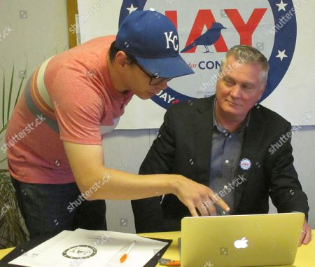 Jay Sidie, right, the Democratic nominee in Kansas' 3rd Congressional District, confers with campaign manager Shawn Borich about the contents of an upcoming mailing to voters at Sidie's campaign headquarters in Mission, Kan. In his campaign against Republican incumbent Kevin Yoder, Sidie has been endorsed by former Democratic Gov. Kathleen Sebelius