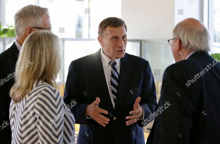 """John Mica Photo, Rep. John Mica, R-Fla., center, greets voters at an event in Maitland, Fla. Mica is seeking a 13th term in Congress from central Florida, but it's not an easy path. The veteran Republican tells supporters turnout is critical. And he's offers them this advice about his re-election contest: ''Don't let it get caught up in any of the other races or issues."""" That seems code for Donald Trump, whose presidential run carries mixed blessings in a tight district. More than Trump is threatening Mica's career. In a battle of old school versus new, Mica faces Democrat Stephanie Murphy, a 38-year-old political neophyte"""