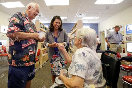 "Stock Image of Stephanie Murphy Florida Democratic Congressional candidate Stephanie Murphy, center, meets with voters at a senior center in Altamonte Springs, Fla. Rep. John Mica, R-Fla., is seeking a 13th term in Congress from central Florida, but it's not an easy path. The veteran Republican tells supporters turnout is critical. And he's offers them this advice about his re-election contest: ''Don't let it get caught up in any of the other races or issues."" That seems code for Donald Trump, whose presidential run carries mixed blessings in a tight district. More than Trump is threatening Mica's career. In a battle of old school versus new, Mica faces Murphy, a 38-year-old political neophyte"