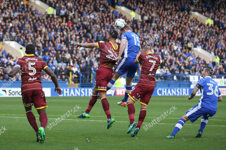 Sheffield Wednesday defender Tom Lees (15)  and Queens Park Rangers  defender Steven Caulker (22) tussle in the air during the EFL Sky Bet Championship match between Sheffield Wednesday and Queens Park Rangers at Hillsborough, Sheffield