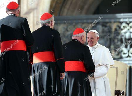 Cardinal Stanislaw Dziwisz, Cardinal Stanislaw Rylko and Cardinal Kazimierz Nycz greet Pope Francis