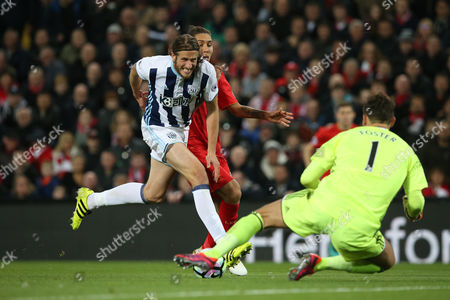 Jonas Olsson shields the ball from Roberto Firmino during the Premier League match between Liverpool and West Bromwich Albion played at Anfield, Liverpool on 22nd October 2016
