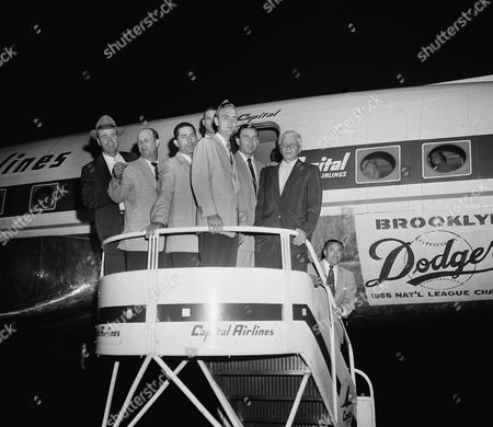 Stock Picture of Manager Walt Alston, left, stands on plane ramp with other members of the National League champion, the Brooklyn Dodgers, on arrival at La Guardia Airport late . The pennant winners arrived from St. Louis aboard a chartered airliner. Left to right: Manager Alston, Dixie Howell, Carl Furillo, Frank Kellett, Gil Hodges and coach Jake Pitler, with secretary Lee Scott standing at bottom of steps