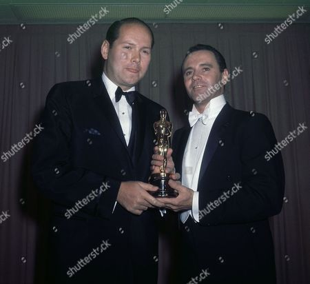 Jack Lemmon, David Pickard Actor Jack Lemmon, wearing white tie, presenting best pix award, to David Pickard, accepting for Tony Richardson for ?Tom Jones? in 1964
