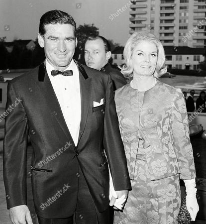 Stock Image of Rod Taylor, Mary Taylor, Mary Hilem Actor Rod Taylor and his wife Mary, arriving for wedding, in Hollywood, Los Angeles of actor Glenn Ford and Kathy Hays