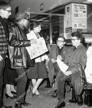 The Rev. Michael Itkin and the Rev. Peter Bandtlow, right, sit at F.W. Woolworth store lunch counter on New York?s herald square on . The two members of the humanist league and church demonstrated with other youths who identified themselves as city college of New York students in protest against segregation at counters in southern stores of chain. Girl is Nora Roberts. The sit-in was sponsored by the New York youth committee for integration at same time that call for nationwide picketing of Woolworth stores was issued by congress of Racial Equality