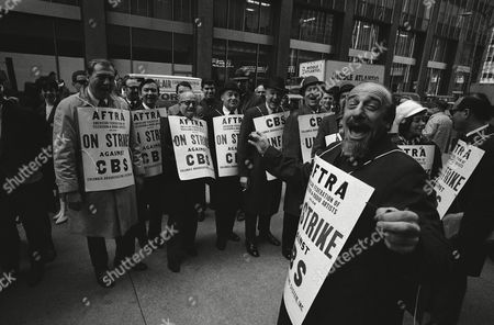 """Bearded Mitch Miller, bandleader and choral director, leads a """"sign along with Mitch"""" group of fellow pickets outside the CBS headquarters in New York, March 30. 1967. They are members of the American Federation of Television Radio Artists (AFTRA) which struck three major radio and television networks March 29"""