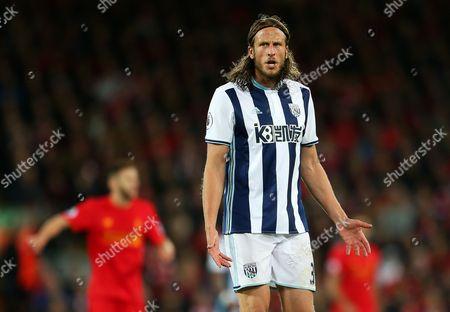 Jonas Olsson of West Bromwich Albion looks dejected