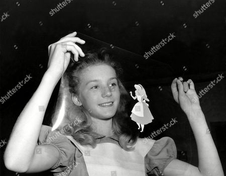 """Beaumont English actress Kathryn Beaumont looks at an animation transperancy after a day's work as the model for Alice in Disney's animated feature film """"Alice In Wonderland"""" in Burbank, Ca., in 1951. Beaumont, a native of London, England, also provides the voice for Alice"""