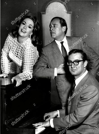 """Stock Photo of ALLEN MEADOWS NYE Set to launch his new summer series on CBS-TV, Steve Allen, at the the piano, rehearses a bit with his wife, Jayne Meadows, and Louis Nye for the first show . The show, """"The Steve Allen Comedy Hour,"""" is to present topical music and comedy acts. Jayne will have a supporting role, while Nye will guest on six programs"""