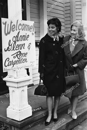 Stock Photo of Annie Glenn (left) and Rene Carpenter read a sign in front of Pickaway Arms in Circleville, Ohio, as the two arrived to campaign for Mrs. Glenn's husband Lt. Col. John H. Glenn Jr., who is seeking Democratic U.S. Senatorial nomination. Glenn plans to begin his campaign April 1. The members of John H. Glenn campaign tour will visit Circleville, Chillicothe and Portsmouth. Mrs. Carpenter is the wife of astronaut Scott Carpenter