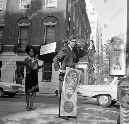 Paul Greenberg, executive director of the New York Council for a sane nuclear policy and his assistant Cheryll Greene carry a coffin draped in black in front of the Soviet United Nations delegation headquarters in New York on . They were protesting Soviet Premier Khrushchev's announcement that Russian would set off a 50-megaton nuclear bomb at the end of month