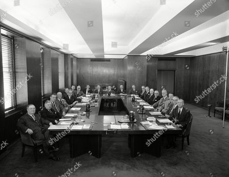 Associated Press board of directors on . Left to right around table are John Runyan; W. D. Maxwell; Bernard Ridder; Robert McLean; Benjamin McKelway; Harold Fitzgerald; Kenneth Macdonald; Lloyd Stratton; George W. Healy, Jr.; Willard Cope; Hugh Boyd; Max E. Nussbaum; Harry Byrd, Jr.; William Dwight; Frank J. Starzel; Harry Montgomery; Eugene S. Pulliam; Wright Bryan; Paul Miller; Henry Bradley; Franklin Schurz