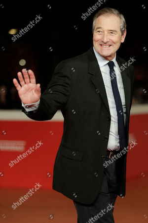 """Actor Julian Wadham poses for photographers as he arrives for the screening of the movie """"The English Patient"""" in Rome"""