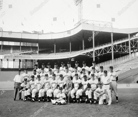 New York Giants baseball team poses on for what is probably their last team portrait in the Polo Grounds, New York City. In 1958 the club will be heading to the west coast to play ball. Front row left to right: Ed Logan, clubhouse custodian; Ray Katt; Ozzie Virgil; Bill Sarni, Coach; Bucky Walters, coach; Dave Williams, coach; Bill Rigney, manager; Eddie Brannick, secretary, Tom Henrich, coach; Valmy Thomas; Stu Miller; Dan O?Connell; Frank Bowman, trainer. Second Row: Don Mueller; Willie Mays; Whitey Lockman Wes Westrum; Daryl Spencer; Curt Barclay; Ray Crone; Ray Jablonski; John ANtonelli; Bob Thomson; Hank Sauer. Back Row: Ruben Gomez; Dusty Rhodes; Gail Harris; Jim Constable; Ed Bressoud; Allan Worthington seated in front: Ed Logan, 3rd, batboy