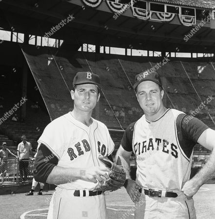 Boston's Bill Monbouguette, left, starting pitcher for the American League, and Pittsburgh's Bob Friend, the National League's starter, pose before the All Star game gets underway on in Kansas City at Municipal Stadium
