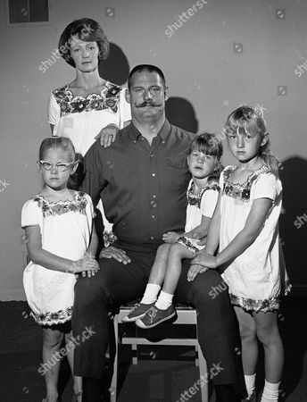Ben Davidson Oakland Raider's defensive lineman Ben Davidson, with his now famous handlebar mustache, poses with his family in an 1890-type Father's Day portrait, at their Hayward, California home. From left: Dana, 5; Wife Kathy Vicky, 3, and Janella, 6. Big Ben's girls all wear matching flower bordered dresses purchased on recent vacation in Mexico