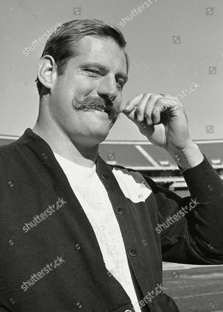 """Ben Davidson Big Ben Davidson, Oakland Raiders defensive end, twirls his period moustache in Oakland, as he contemplates the coming meeting with the Green Bay Packers for the Pro Football Championship. Davidson, who was on the Green Bay roster for a year, says """"they sent me down; It's going to be a big thrill to play the Backers."""" The Raiders are credited with the best defensive unit in the American Football League"""