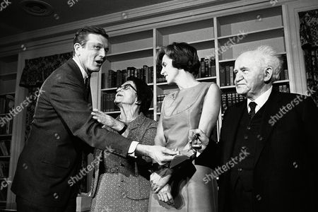 Stock Image of New York City Mayor John V. Lindsay presents a sterling silver trowel to David Ben-Gurison, March 13, at Gracie mansion. Ben-Gurison former prime minister of Israel was given the trowel in recognition of his pioneering spirit. Mrs. Paula Ben-Gurison and the mayor's wife Mary Anne are between the two men