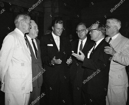 Stock Image of Billy Graham Evangelist Billy Graham shown with a group of senators at a Capitol luncheon in Washington on where he was a guest of the Senate. From left: Senators Henry Dworahak (R-Idaho), John McClellan (D-Ark), Gordon Allott (R-Colo); Graham; Samuel Erwin (D-NC),and A. Willis Robertson (D-Va