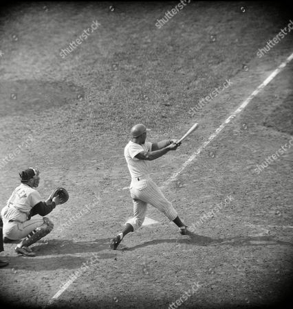 Billy Williams, Billy L. Williams, Billy Leo Williams Billy Williams of the Chicago Cubs clouts his 12th home run of the season in the ninth inning against the Milwaukee Braves in Chicago, Ill., . Williams homer boosted his batting average to .414. He also hit a double and two singles in four times at bat. The Milwaukee catcher is Ed Bailey. Despite Williams' work at the plate, The Braves won 6-5