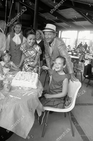 Bing Crosby, Kathryn Crosby, Mary Frances Crosby Kathryn and Bing Crosby are like any two proud parents as daughter Mary Frances Crosby prepares to cut the cake on the occasion of her ninth birthday in Redwood City, California on . Event took place at the Marine World, the new Peninsula education and entertainment center where the senior Crosby is filming an ABC-TV half hour special to be released next February. A dozen young friends of Mary were present for the happy occasion